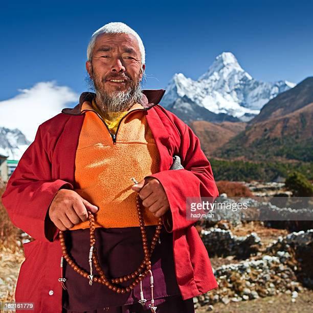 Buddhist monk on the background of Ama Dablam