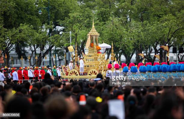 Buddhist monk on The Rajarot Noi carrying the Supreme Patriarch is pulled during the funeral procession for the late Thai king Bhumibol Adulyadej in...