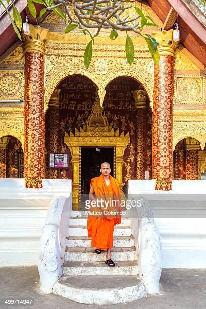 Buddhist monk outside temple, Luang Prabang, Laos