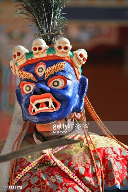 Buddhist monk performs ancient sacred dances during the Lamayuru Masked Dance Festival in Lamayuru Ladakh Jammu and Kashmir India The dance...