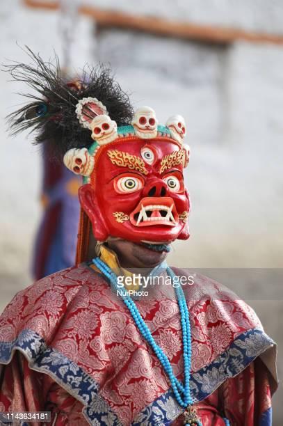 Buddhist monk performs ancient sacred dances during the Lamayuru Masked Dance Festival in Lamayuru, Ladakh, Jammu and Kashmir, India. The dance...