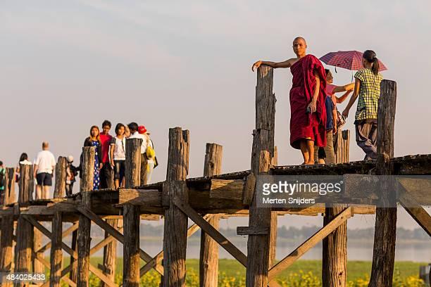 Buddhist monk posing on U Bein bridge