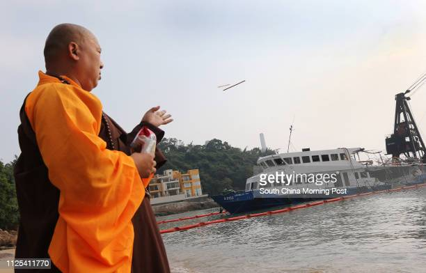 A Buddhist monk pray to victims near the HK Electric ferry Lamma IV Pictured at Nga Kau Wan Lamma Island 03OCT12