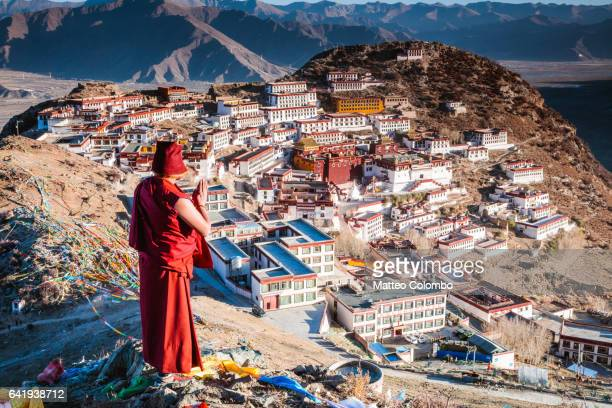 Buddhist monk praying, Ganden monastery, Tibet