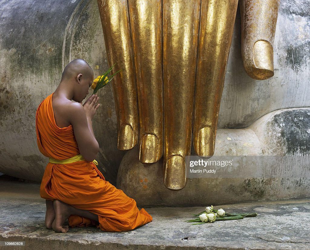 Buddhist Monk Praying Stock Photo - Getty Images