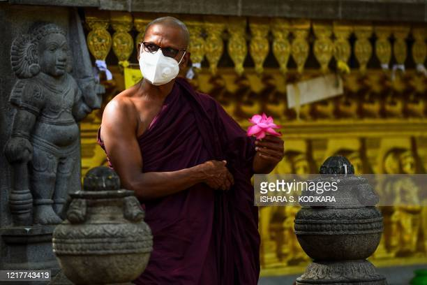 A Buddhist monk prays at the Kelaniya temple during the Poson Poya religious festival marking the arrival of Buddhism in the island on the outskirts...