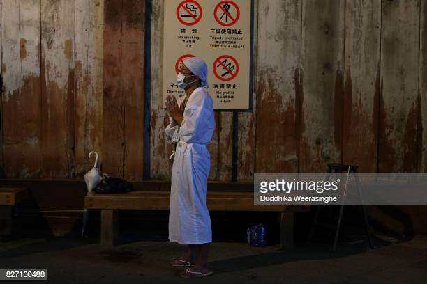 Buddhist monk prays before cleaning the dust off of 'Daibutsu' or the Great Buddha during the annual cleaning at Todaiji Temple on August 7 2017 in...