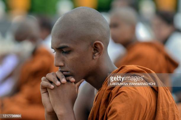 A Buddhist monk prays in Sri Vidyashanthi Temple in Colombo on June 5 during the Poson Poya religious festival Sri Lanka celebrates Poson a Buddhist...