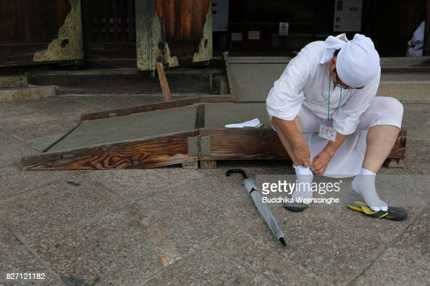 Buddhist Monk prepares to clean the dust off of 'Daibutsu' or the Great Buddha and inside the temple during the annual cleaning at Todaiji Temple on...