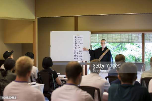 A Buddhist monk speaks during a mindfulness lesson at a cultural experience program part of Mitsubishi UFJ Financial Group Inc's Global Analyst...