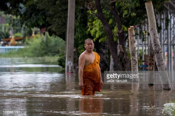 Buddhist monk stands amid floodwaters in Ayutthaya on October 4 after tropical storm Dianmu caused flooding in 31 provinces across the country.
