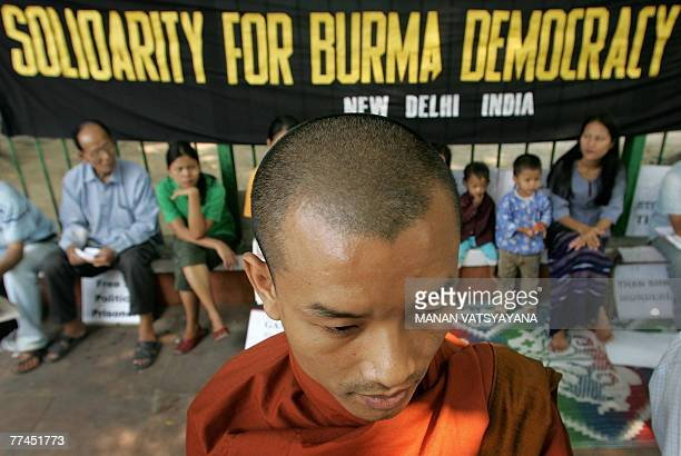 A Buddhist monk takes part in a sitin demonstration to welcome a visit by UN's special envoy to Myanmar Ibrahim Gambari in New Delhi 23 October 2007...