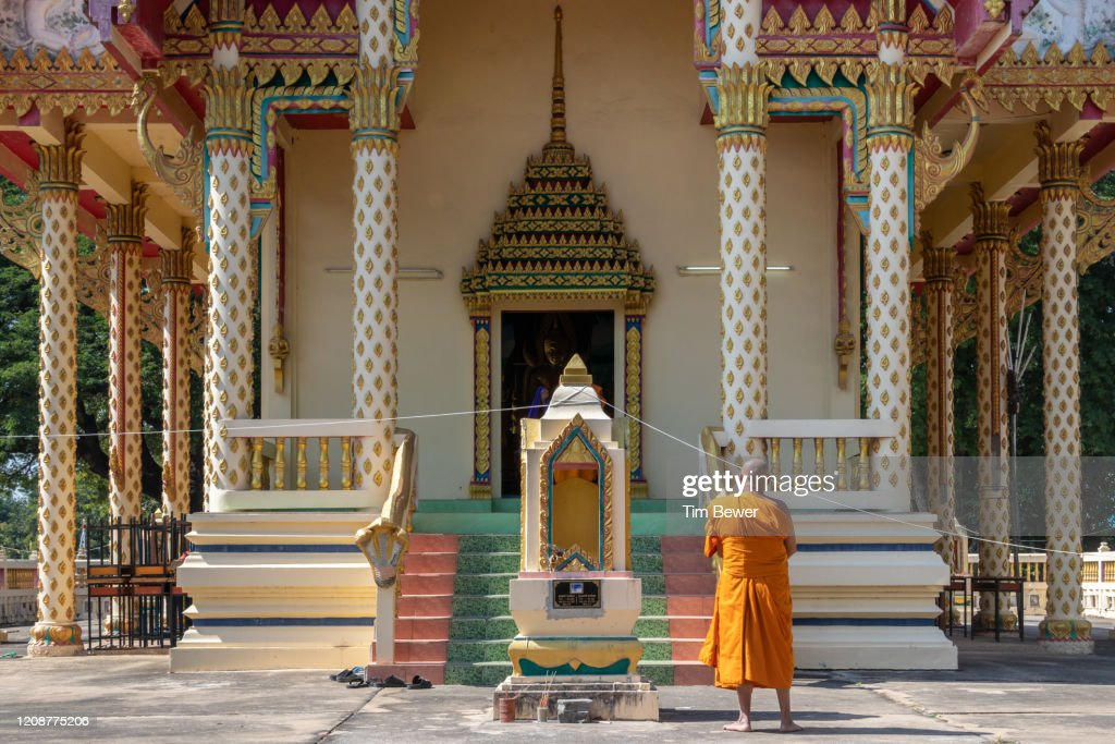Buddhist monk waiting outside ubosot before confessional meeting. : Stock Photo