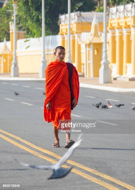 Buddhist Monk walking by The Royal Palace in Phnom Penh in Cambodia.