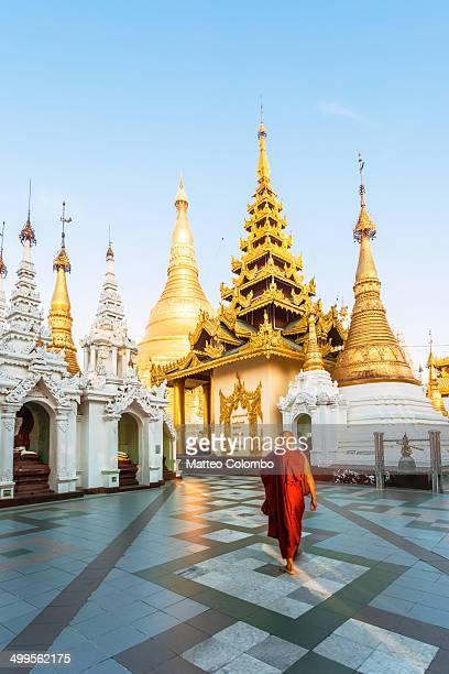 Buddhist monk walking near temple, Yangon, Myanmar