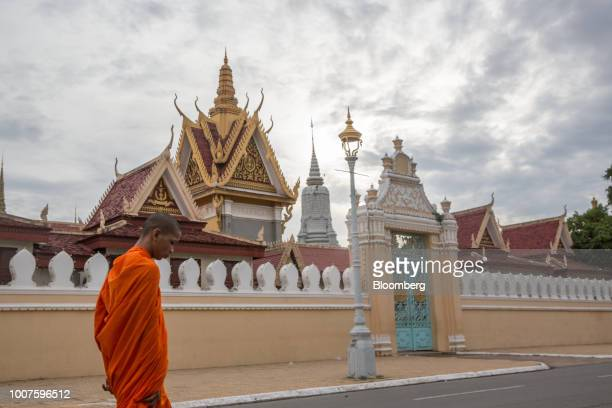 A Buddhist monk walks past the Royal Palace in Phnom Penh Cambodia on Sunday July 29 2018 Cambodian Prime MinisterHun Senextended his...