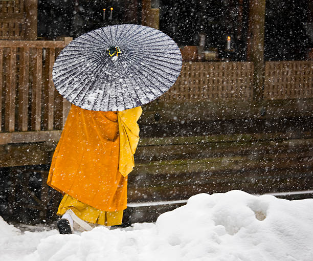A Buddhist monk walks through a snow flurry in Koyasan, a centre for Shingon Esoteric Buddhism.