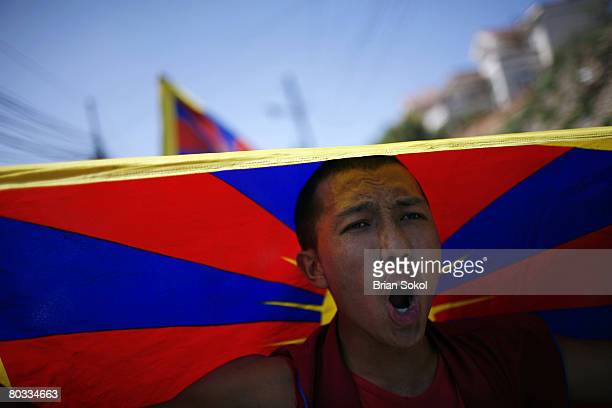 Buddhist monk waves a Tibetan flag during a proTibet march through the streets on March 19 2008 in Kathmandu Nepal Tibetans have been protesting...