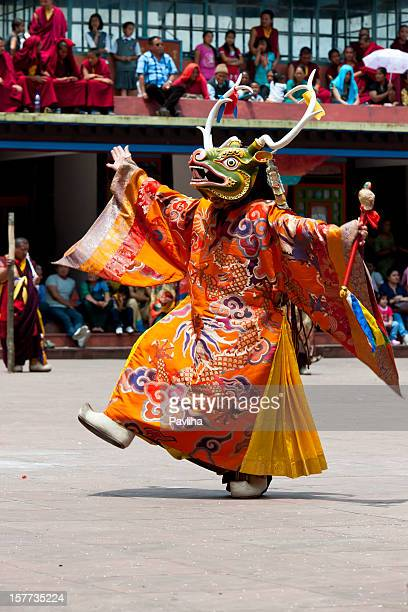 buddhist monk with mask during festival sikkim - sikkim stock pictures, royalty-free photos & images