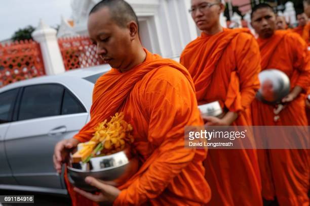 DUSITVANARAM BANGKOK THAILAND Buddhist monks accept offerings from the faithful at Benchamabophit Dusitvanaram