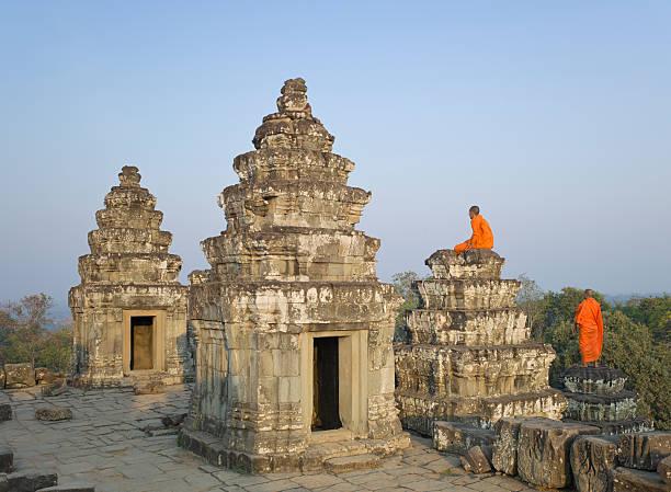 Buddhist monks amongst Temple ruins