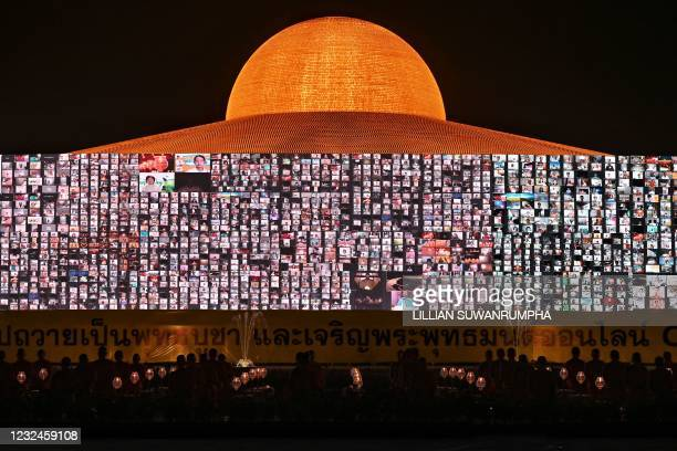 Buddhist monks and devotees attend prayer via Zoom call as they light 330,000 candles in an attempt to break the Guinness World Record for the...