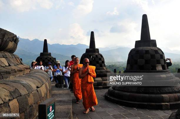 Buddhist monks and devotees conduct prayers at Borobudur temple during Vesak day in Magelang on May 29 2018 Buddhist devotees in Indonesia celebrated...