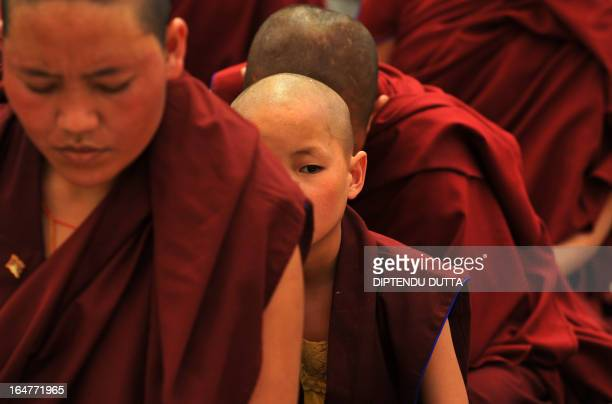 Buddhist monks and nuns attend a preaching seesion of Tibetan spiritual leader the Dalai Lama at The Kalachakra Phodong Monestry in Salugara on the...