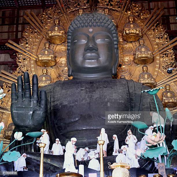Buddhist monks and volunteers gather to clean the dust from the 15meterhigh Great Buddha at the Todaiji Temple on August 7 2006 in Nara Japan The...
