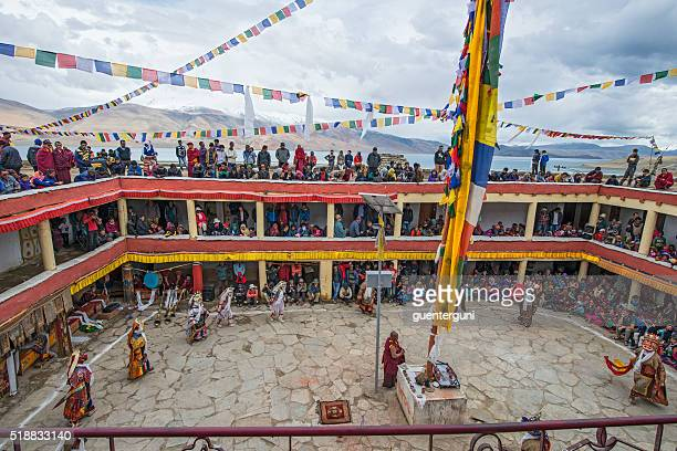 Buddhist monks are performing a sacred dance in Ladakh.