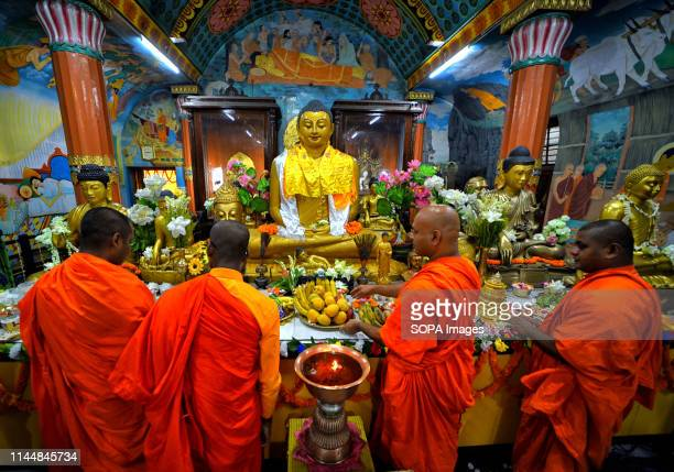 Buddhist monks are seen praying in front of a statue of Lord Buddha during the Buddha Purnima Prayers. Buddha's birthday is a holiday traditionally...