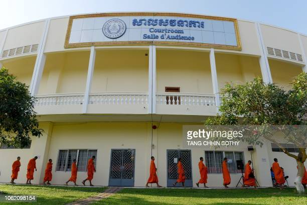 Buddhist monks arrive at the court building to attend the verdict of former Khmer Rouge leaders Khieu and Brother Number 2 Nuon Chea at the...