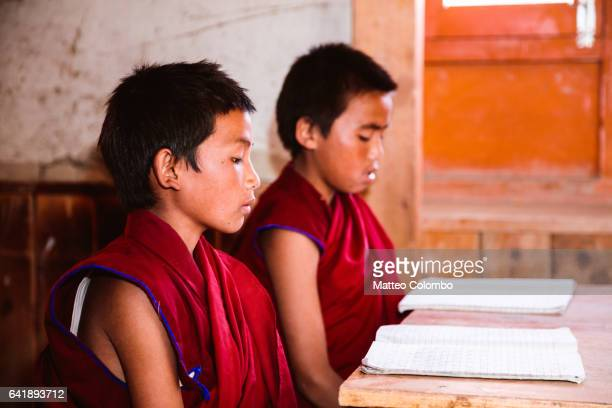 buddhist monks at school, upper mustang, nepal - traditional clothing stock pictures, royalty-free photos & images