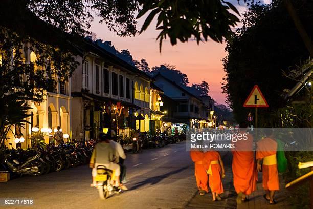 Buddhist monks at sunset