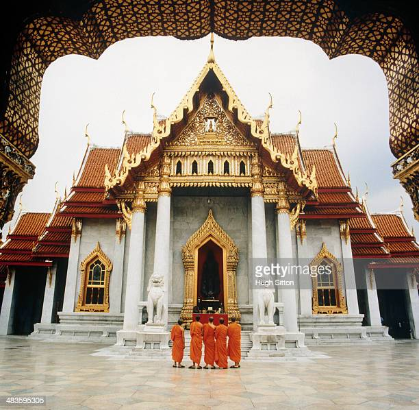 buddhist monks at temple - wat benchamabophit stock photos and pictures