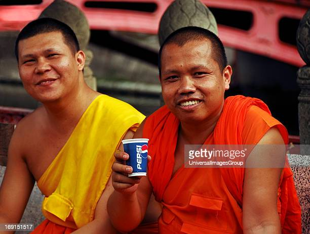 Buddhist monks at the Wat Benchamabophit temple marble temple Bangkok Thailand