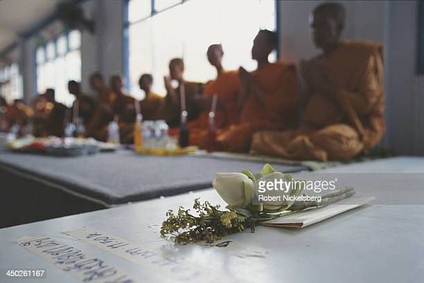 Buddhist monks attend a funeral ceremony for a deceased AIDS patient at the Wat Phra Bat Nam Phu buddhist temple in Lop Buri which provides care for...