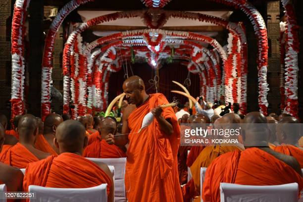 Buddhist monks attend a special prayer ceremony for relief of the outbreak of COVID-19 , at the Temple of the Sacred Tooth Relic in Kandy on March...