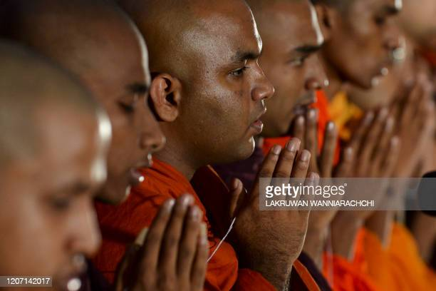 Buddhist monks attend a special prayer ceremony for the relief from the spread of the COVID19 novel coronavirus at the Independence Memorial Hall...