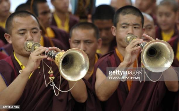 Buddhist monks attend the funeral of senior Tibetan Buddhist monk Shamar Rinpoche at Shar Minub monastery in Kathmandu on July 31 2014 Thousands of...