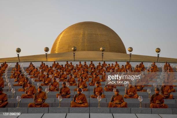 Buddhist monks attend the Makha Bucha celebrations at Wat Dhammakaya, north of Bangkok on February 26, 2021.