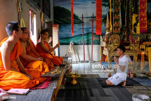 Buddhist monks chant prayers for the faithful during religious services at a small rural temple Thailand is a predominately Buddhist nation