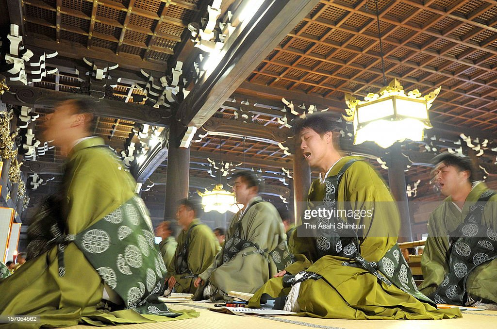 Buddhist monks chant with their heads shaking, during the Ho-On-Ko, memorial service to commemorate Shinran, founder of their Buddhist sect Jodo Shinshu, at Higashi Honganji Temple on November 28, 2012 in Kyoto, Japan. Shinran passed away on November 28, 1262 and the event is the climax of a-week-long memorial service.