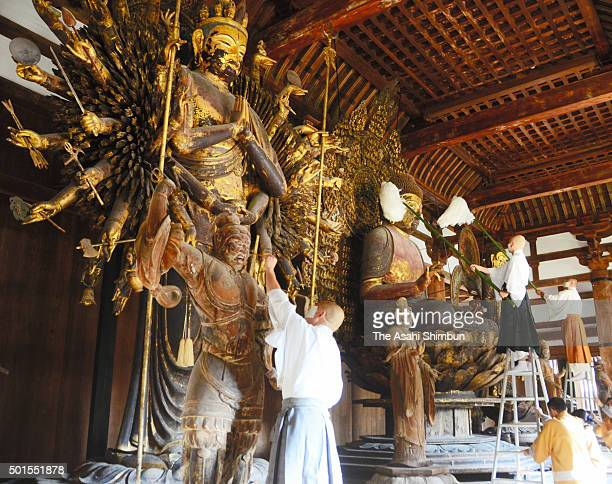 Buddhist monks clean the statues during the 'Ominugui' ritual annual dusting at Toshodaiji Temple on December 15 2015 in Nara Japan