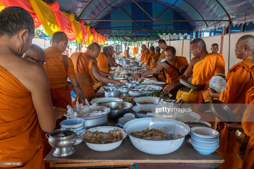 Buddhist monks collecting morning alms at a temple. : Stock Photo