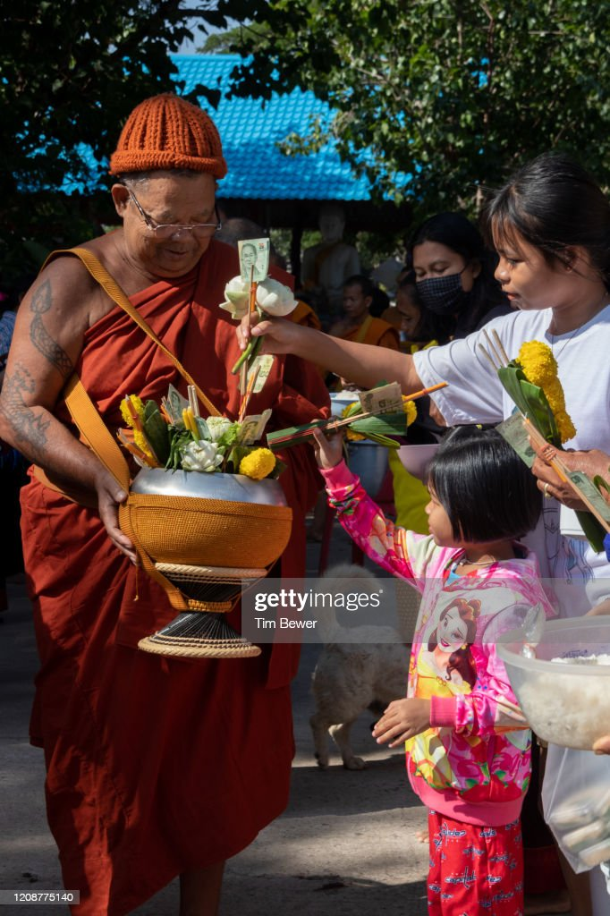 Buddhist monks collecting morning alms : Stock Photo