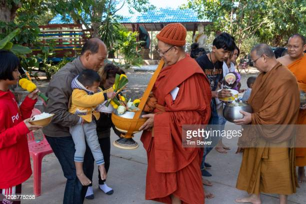 buddhist monks collecting morning alms - tim bewer fotografías e imágenes de stock