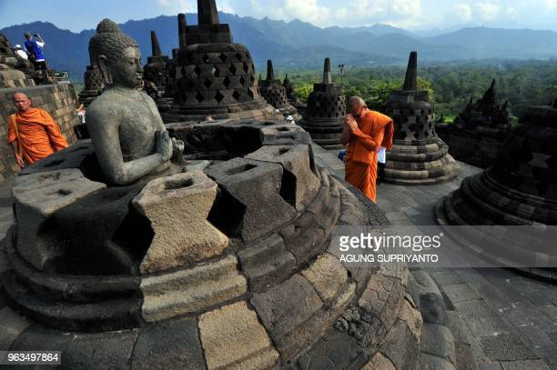 Buddhist monks conduct prayers at Borobudur temple during Vesak day in Magelang on May 29 2018 Buddhist devotees in Indonesia celebrated Vesak Day on...