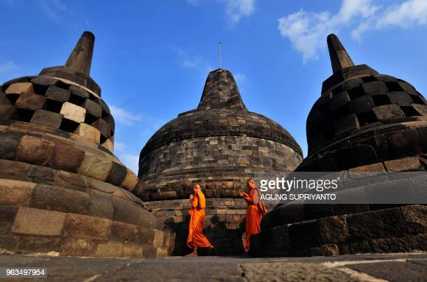 TOPSHOT Buddhist monks conduct prayers at Borobudur temple during Vesak day in Magelang on May 29 2018 Buddhist devotees in Indonesia celebrated...