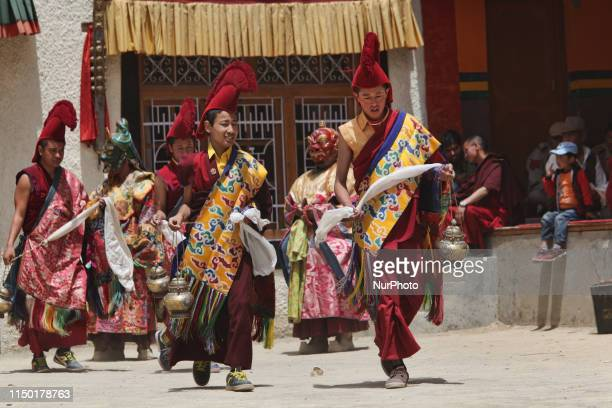 Buddhist monks dressed in ceremonial attire during the Lamayuru Masked Dance Festival in Lamayuru Ladakh Jammu and Kashmir India The dance...
